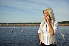 Girl talking on a cell phone Stock Image