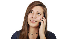 Girl talking on cell phone. Young girl talking on cell phone over white background Stock Images