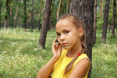 Girl talking on cell phone Stock Images