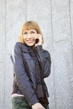 Girl talking on a cell phone. Royalty Free Stock Photos
