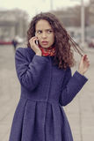 Girl talking on cell phone and she was very unhappy Royalty Free Stock Photos