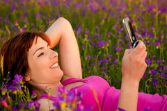 Girl talking on cellphone Royalty Free Stock Images