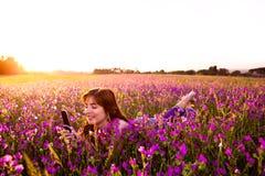 Girl talking on cellphone Stock Image
