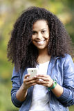 Girl talking on cellphone Royalty Free Stock Image