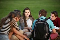 Girl Talking with Classmates Royalty Free Stock Image