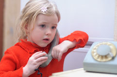 Girl talking on dial phone Royalty Free Stock Photography