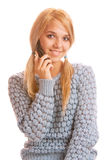 Girl talking on her cell phone and smiling Stock Photography