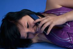 Girl talking on her mobile phone laughing Stock Images