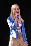 Girl talking in microphone copy space Royalty Free Stock Photos