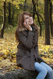 Girl talking on a mobile phone Royalty Free Stock Photography