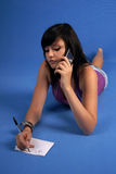 Girl talking on mobile phone Royalty Free Stock Photos