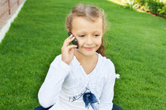 Girl talking on mobile phone Stock Image