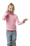 Girl talking by mobile phone. Beautiful girl smiles and talks by mobile phone, isolated on white Royalty Free Stock Photography