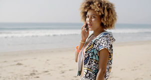 Girl Talking At Mobile Phone On The Beach Stock Image