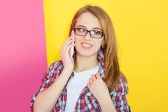 Girl talking on mobile phone Stock Photos