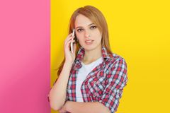 Girl talking on mobile phone Stock Images