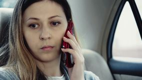 Girl talking on a mobile phone stock footage