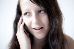 Girl talking on a mobile phone Royalty Free Stock Images