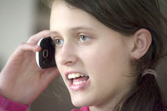 Girl talking on mobile Royalty Free Stock Image
