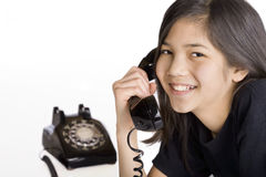 Girl talking on old phone Stock Photo