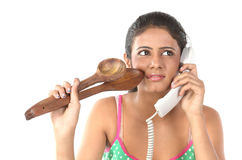 Girl talking over telephone with wooden sticks Stock Image