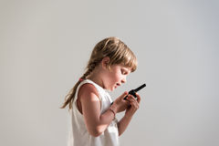 Girl talking over walkie-talkie Royalty Free Stock Image