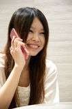 Girl talking on the phone. Smiling girl talking on the phone Royalty Free Stock Image