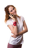 Girl talking on the phone. Pretty red-haired girl talking on the phone Royalty Free Stock Images