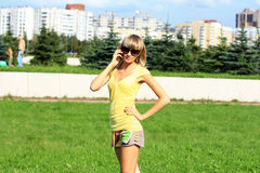 Girl talking on the phone. Stock Images