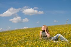 Girl talking on the phone 2. Girl talking on the phone in a land full of flowers Stock Photo