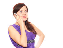 Girl talking the phone. Girl in a violet dress on a white background talks via phone Stock Photo