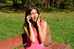 Girl talking by phone Royalty Free Stock Photos