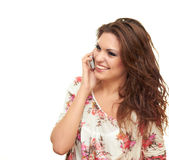Girl talking the phone. Beautiful smiling girl isolated on a white background talking on the phone Royalty Free Stock Images