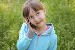 Girl talking on the phone.  Stock Image