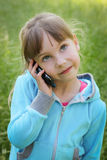Girl talking on the phone.  Stock Photography