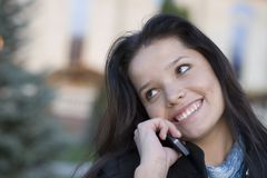 Girl talking by phone Royalty Free Stock Image