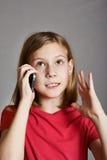 Girl talking on phone Royalty Free Stock Photos