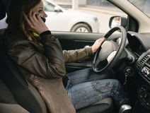 Girl talking on the phone in the car royalty free stock photo