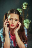 Girl talking on phone and crying. Royalty Free Stock Photo