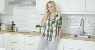 Girl talking by phone at home Royalty Free Stock Photography