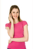 Girl talking on the phone. Isolated on white Royalty Free Stock Photography