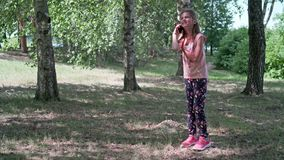The girl is talking on the phone stock video footage