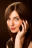 Girl talking on the phone over black. Beautiful girl talking on the phone over blackrr Stock Photos