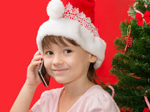 Girl talking by the phone Stock Photography