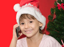 Girl talking by the phone Stock Image