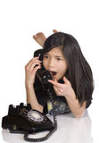 Girl talking on phone, surprised Royalty Free Stock Photos