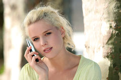 Girl talking on the phone Stock Photos