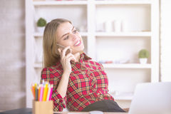 Girl talking on phone and workplace Stock Photo