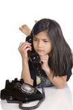 Girl talking on phone, worried Stock Images