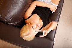 Girl talking with a Smartphone Royalty Free Stock Photography